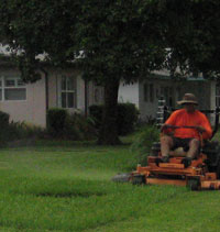 Man mowing a lawn with a riding mower