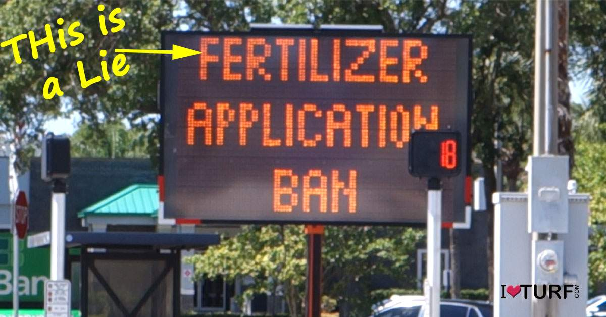 "Lighted sign says ""Fertilizer Application Ban with handwritten note says This is a lie"